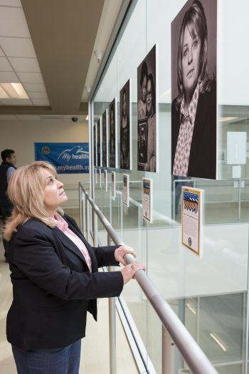 Angela Burton gazes up to her portrait on March 2, 2018, at the VA Health Care Center at Harlingen, Texas.