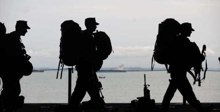 IMAGE: Military service members on a ship