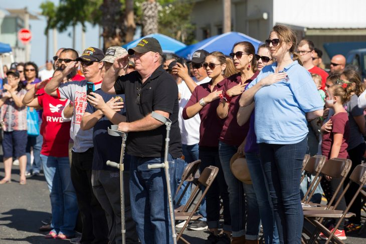 Guests attending the 2018 Welcome Home event for Veterans rise to their feet and pay respect during the singing of the Star-Spangled Banner. (U.S. Department of Veterans Affairs photo by Reynaldo Leal)