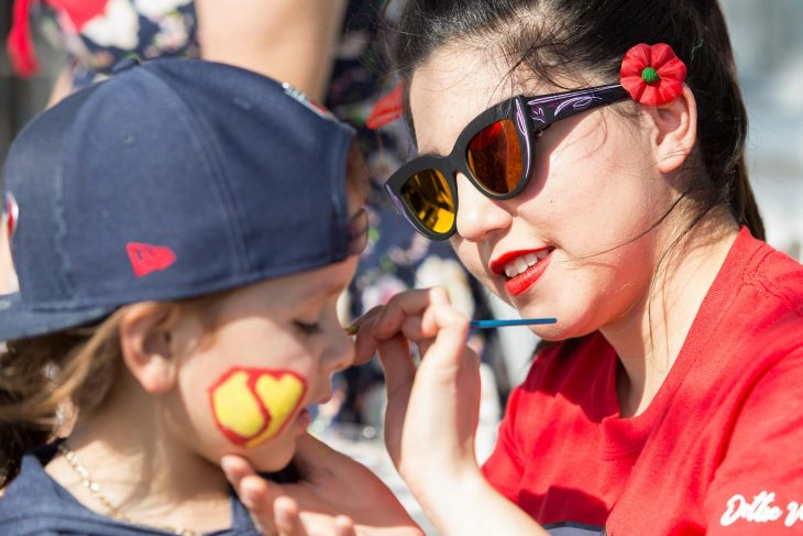 RGV Pin-Ups member Rebecca Lee Gutierrez paints the face of a child during the 2018 Welcome Home event for Veterans. (U.S. Department of Veterans Affairs photo by Reynaldo Leal)