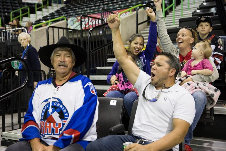 (At bottom right) Army Veteran Daniel Fiallos-Diaz and his family cheer on the Corpus Christi Ice Rays during a game against the Odessa Jackalopes.(U.S. Department of Veterans Affairs photos by Luis H. Loza Gutierrez)