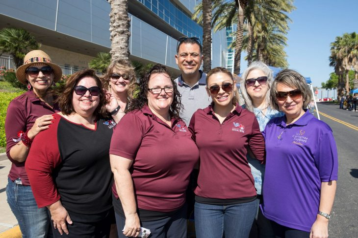 (At center) VA Texas Valley Coastal Bend Health Care System acting director Michael Ojeda poses for a group photo with VA social workers during the 2018 Veterans Welcome Home event. VA Texas Valley Coastal Bend Health Care System and the Corpus Christi Ice Rays teamed up to host the 2018 Welcome Home event for Veterans on March 31, 2018. (U.S. Department of Veterans Affairs photo by Reynaldo Leal)