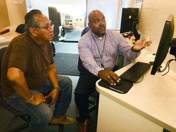 IMAGE: My HealtheVet coordinator Elliott Moore conducts one-on-one training with Navy Veteran Pedro Ortiz Jr. during one of two My HealtheVet Training sessions for Veterans held by the VA and Workforce Solutions Cameron held April 19, 2018. (U.S. Department of Veterans Affairs photo by Luis Loza Gutierrez)