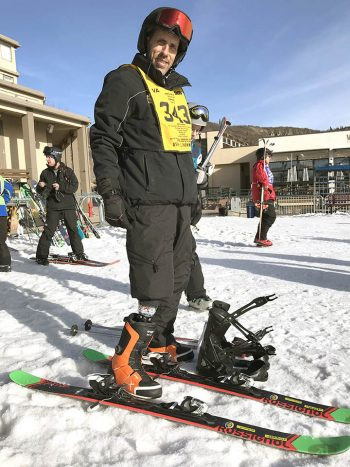 veteran with prosthetic limb standing in skis