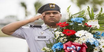 Mighty Eagle Battalion Junior R.O.T.C. Cadet Pvt. Esequiel Martinez salutes during the playing of the national anthem.