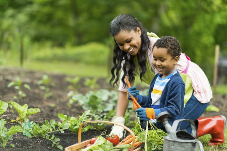 Mother and son gardening together