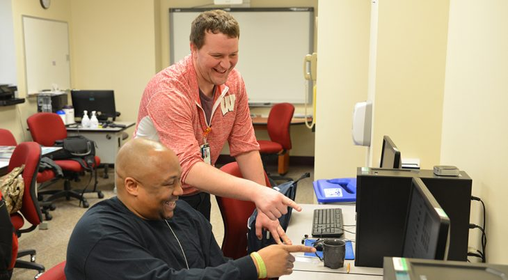 Navy Veteran Maurice Williams and Lee Pingel, Community Employment Coordinator, enjoying interacting during a SAW training session. Photos by Mark Cristler, Visual Information Specialist