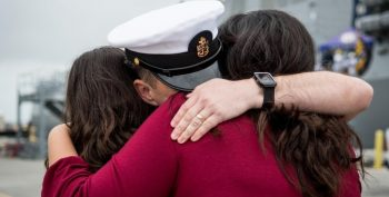 IMAGE: Family hugging a sailor.