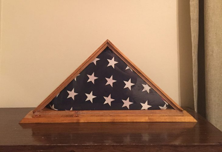 Incased in the shadow box made by her brother Rick and proudly displayed on the mantel inside the home of her other brother, Michael, stands the flag of Air Force Veteran Christine M. Casselberry, after several years of being lost.  (Image courtesy of Mick Casselberry)