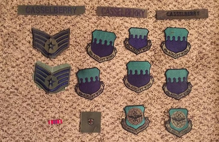 Photo of patches and a service ribbon used by Air Force Veteran Christine Casselberry on her battle dressed uniform(BDU). Patches were placed inside the case housing her memorial flag. Among the BDU patches were staff sergeant insignias, enlisted medical badge, and shields representing Air Mobility Command and the 43d Airlift Wing. (Image courtesy of Mick Casselberry)