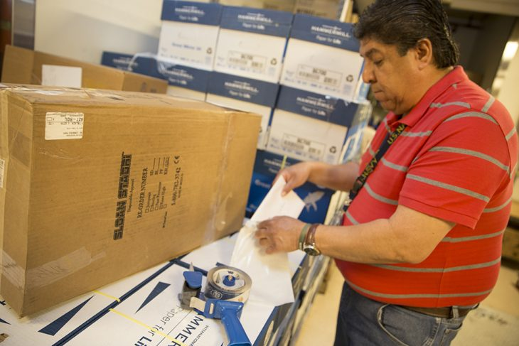 Joseph Ramos a Navy Veteran and VA employee prepares for shipment the package containing the long, lost memorial U.S. flag of Air Force Veteran Christine M. Casselberry on April 6, 2018. The flag traveled approximately 1,200 miles to the home of Michael Casselberry, who along with several members of his family thought they would never again see their sister's flag. (U.S. Department of Veterans Affairs photo by Luis H. Loza Gutierrez)