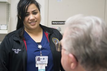 Nurse Corrine Dularte discusses care with a Veteran patient