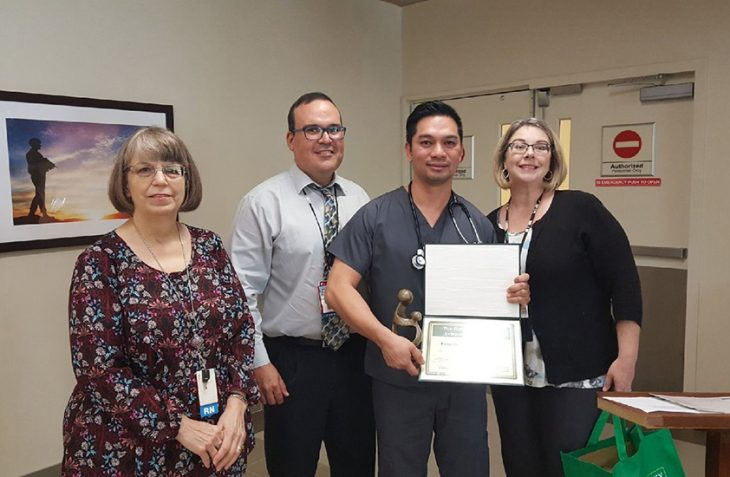 VA Texas Valley Coastal Bend Health Care System senior nursing leadership members Jean Dunn, Rolando Ramos and Stephanie Dominguez pose for group photo with VA registered nurse Renante B. Dizon, who holds up the trophy and certificate from the DAISY Foundation during an official awards ceremony, which took place April 24, 2018, at the VA's McAllen Outpatient Clinic in McAllen, Texas. The 46-year-old nurse was recently recognized as a recipient and 2018 honoree of The DAISY Award For Extraordinary Nurses. (U.S. Department of Veterans Affairs photo by Oren Treviño)