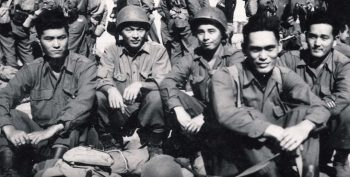 black and white photograph that shows a group of nisei soldiers relaxing