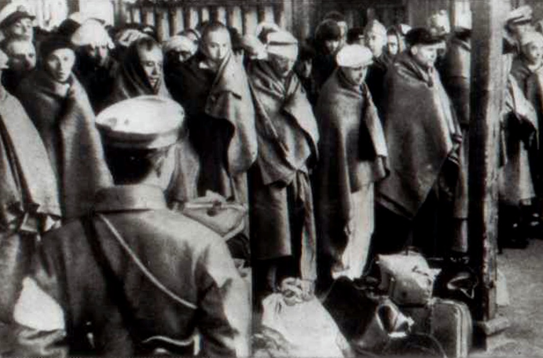 In this Japanese propaganda photo released in March 1942, U.S. service members from Guam arrive at Zentsuki POW camp on Shikoku Island in Japan. Jack Schwartz was one of about 400 U.S. POWs captured at Guam and taken there.