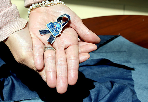 Denim Day photo with Denim Ribbon and I CARE pin taken April 18, 2018. Blanca Benavides posed as hand model. (U.S. Department of Veterans Affairs photo by Luis H. Loza Gutierrez)  Public Service Announcement:  The VA Harlingen Outpatient Clinic is scheduled to have a Clothes Line on display in observance of Sexual Assault Awareness Month. The Clothes Line will be on display from April 25 to May 4. The Clothes Line will feature shirts with messages and imagery in support of the VA's national sexual assault awareness and prevention campaign. Unlike years before, this year's clothes line will feature some clothing items made of denim. April 25, 2018, is International Denim Day.