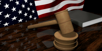 IMAGE: A US Flag and a gavel on a bench