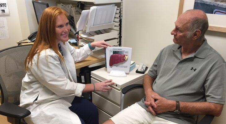Clinical Pharmacist Dr. Amanda Atherton discusses hepatitis C treatment methods with Navy Veteran Dennis Demille