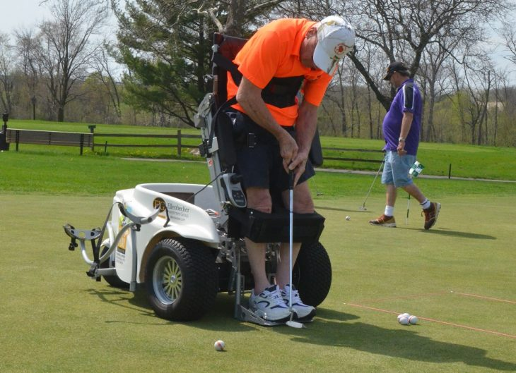 Pete Mittelstaedt golfs with the aid of a Paramobile, a specially designed cart maintained by the Stand Up and Play Foundation.