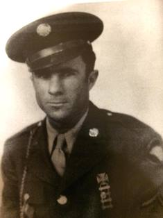 IMAGE: WWII-era photo of Private First Class Broussard in uniform