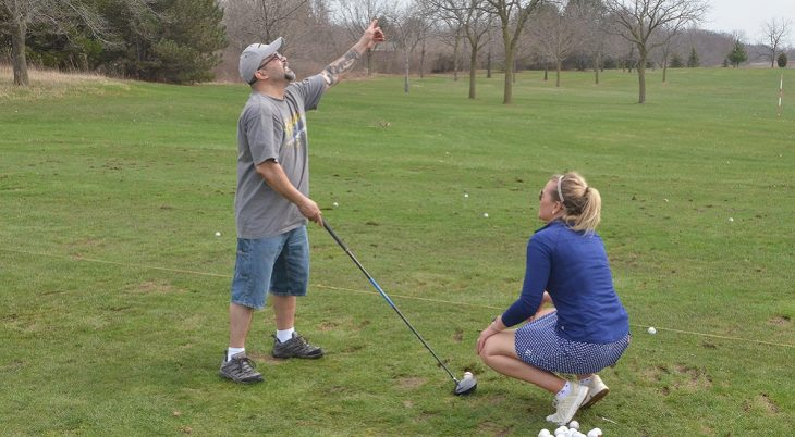 Ray Martinez gets advice on his golf swing from volunteer instructor Erika Pirkl, Player Development Coordinator with Wisconsin PGA.
