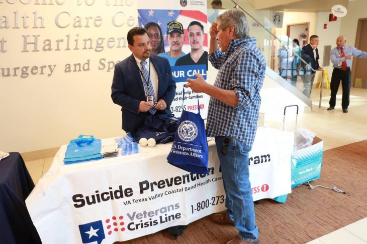 Dr. Rodolfo A. Quintana, a psychologist and the suicide prevention coordinator hears the concerns of Army and Vietnam War Veteran Armando Solomon during the 2017 Veterans Month Kick Off, which took place Nov. 1, 2017, inside the lobby of the VA Health Care Center in Harlingen, Texas. Quintana along with several VA social workers and mental health professionals hand out goodies such as stress balls and wristbands baring he Veterans Crisis Line number and information at various public outreach events throughout the year. (VA archve photo by Luis H. Loza Gutierrez)