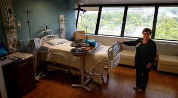 A female nurse presents an upgraded hospital room