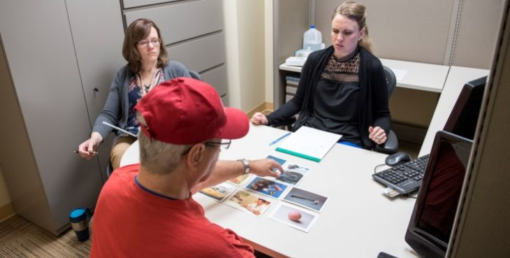 IMAGE: SLP Sarah Kiefer Luhring (left) observes VA Pittsburgh staff SLP Ronda Winans Mitrik and Army Veteran Frank Shandorf of Greensburg, Pennsylvania,during an aphasia therapy session with photos of common objects to spur language recall.