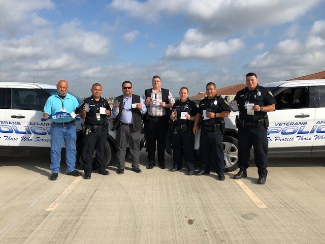 Members of the VA Police Department at VA Texas Valley Coastal Bend Health Care System, show that they have completed the VCL Challenge by holding up their phones to show that they've added the Veterans Crisis Line number to their contacts list on July 20, 2018. The VAPD took this photo on the fifth floor of the parking garage of the VA Health Care Center at Harlingen,Texas. You too can complete the VCL Challenge and add Veterans Crisis Line number 1-800-273-8255 and Press 1 to your contacts list. It could save your life or the life of a Veteran you may know. (U.S. Department of Veterans Affairs photo by Cecilia Garza-Garcia)