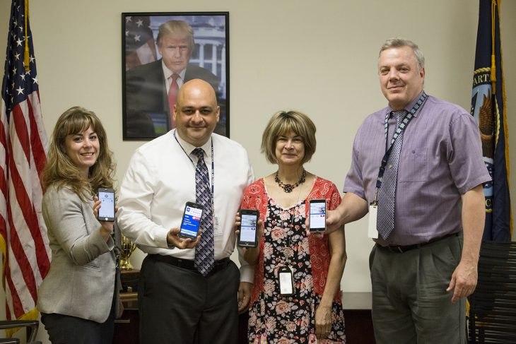 Members of the executive leadership team for VA Texas Valley Coastal Bend, (left to right) Dr. Jennifer Wood, Acting Director Homero Martinez III, Nurse Executive Catherine Mezmar, and Acting Deputy Director Dan Caufield, hold their cell phones with the Veterans Crisis Line phone number on display on July 17, 2018, at the VA Health Care Center at Harlingen, Texas. The team is challenging all VCB employees and volunteers to add the VCL number (1-800-273-8255 Press 1) to their phone contacts list. (U.S. Department of Veterans Affairs photo by Reynaldo Leal)