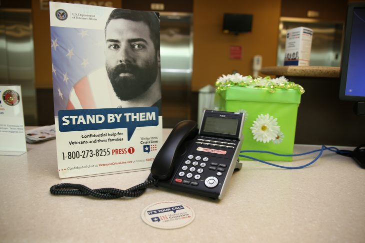 Coasters and mini posters with the Veterans Crisis Line number such as those shown in this photo can be found throughout the different work areas at the VA Health Care Center at Harlingen, Texas. Photo taken on July 20, 2018. Dozens of VA employees took part in the VCL Challenge by saving the Veterans Crisis Line number to their phone contacts list. (U.S. Department of Veterans Affairs photo by Luis H. Loza Gutierrez)