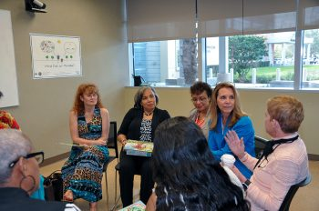 Six people holding discussion in conference room