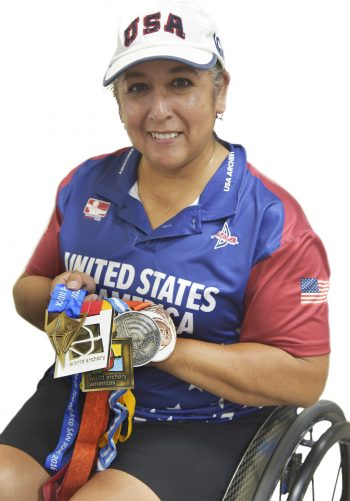 Chavez shows some of the medals she has earned competing for the U.S. Paralympic Archery