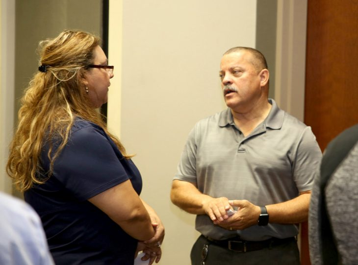 Dr. Milton J. Grisham Jr., the dental service chief for VA Texas Valley Coastal Bend Health Care System speaks with a dental vendor during a vendor health care fair at the UTRGV Academic and Clinical Research Building in Harlingen, Texas, on August 9, 2018. (U.S. Department of Veterans Affairs photo by Luis H. Loza Gutierrez)