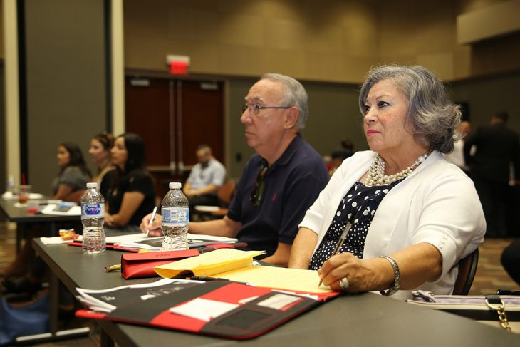 Health care vendors Conrado and Sandi Balli take notes during a presentation regarding the Vendor Inquiry System during the vendor health care fair at the UTRGV Academic and Clinical Research Building in Harlingen, Texas, on August 9, 2018. (U.S. Department of Veterans Affairs photo by Luis H. Loza Gutierrez)
