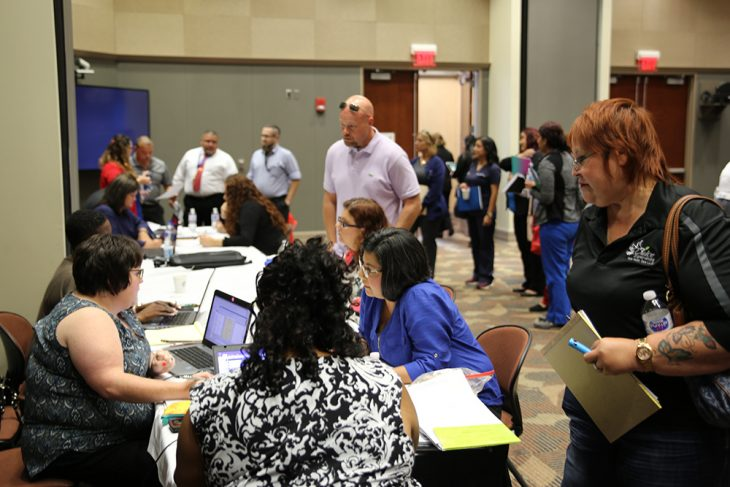 VA Office of Community Care employees from Bonham, Texas, and employees from the Community Care Program at VA Texas Valley Coastal Bend Health Care System assist vendors with specific cases and concerns about the VA billing process during a vendor health care fair aUTRGV Academic and Clinical Research Building in Harlingen, Texas, on August 9, 2018. (U.S. Department of Veterans Affairs photo by Luis H. Loza Gutierrez)