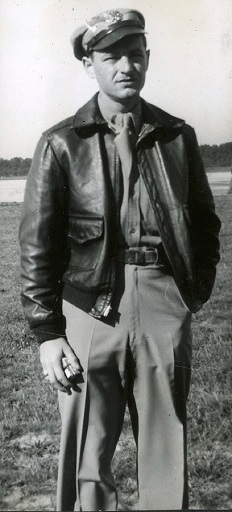 black and white photograph shows Robert Joseph Andrews psoing for a photograph wearing his pilot jacket