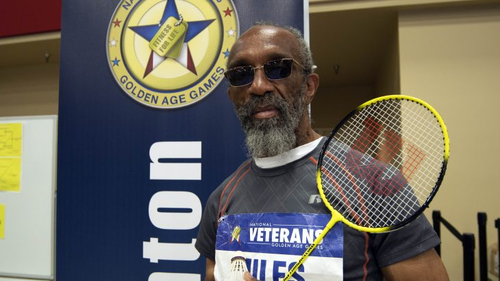 Veteran with badminton racquet