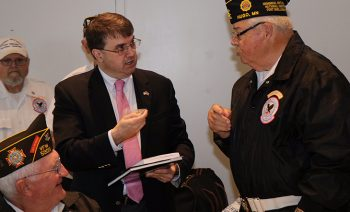 IMAGE: Wilkie talking to VSO member