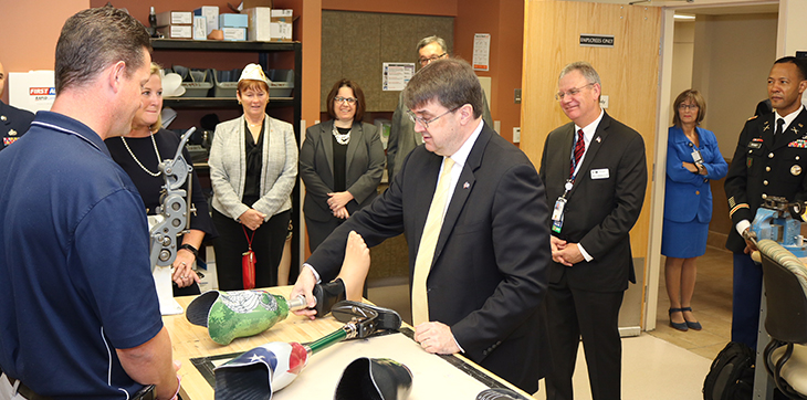 IMAGE: Sec. Wilkie visiting facility