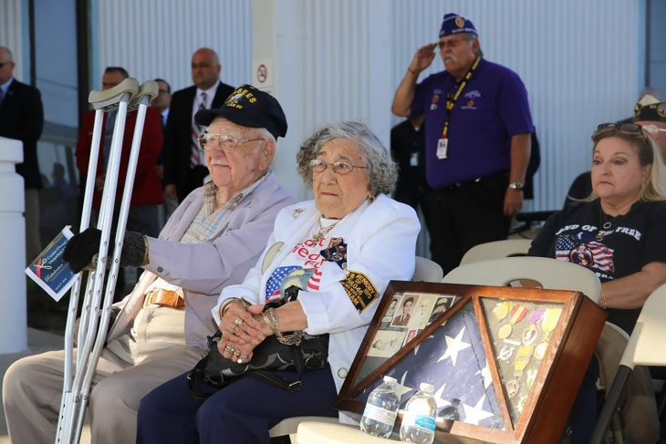 Gold Star Family parents Gilbert and Velia Alaniz sit and listen to the Veterans Band of Corpus Christi Texas play the Army service song during the rededication ceremony of the VA outpatient clinic in Corpus Christi, Texas, held on April 27, 2018.
