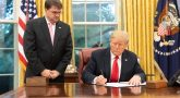 President Donald J. Trump, joined by U.S. Secretary of Veterans Affairs Robert Wilkie, signs H.R. 2147, The Veterans Treatment Court Improvement Act of 2018 Monday, Sept. 17, 2018, in the Oval Office of the White House. (Official White House Photo by Joyce N. Boghosian)