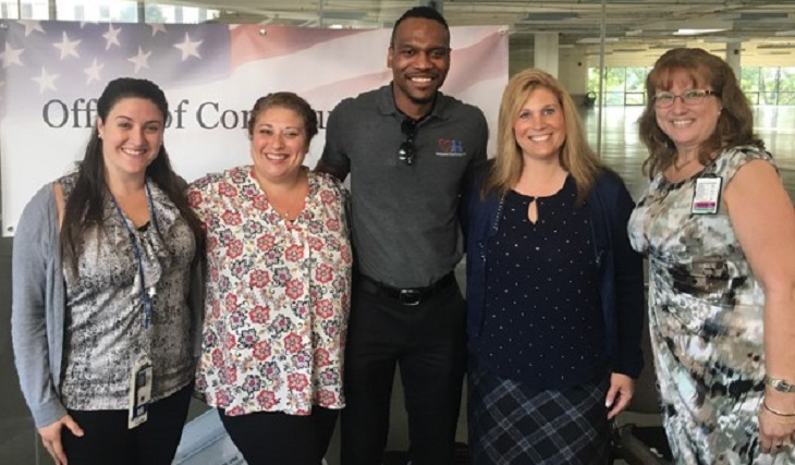 "IMAGE: Jamal Strange, Medical Director of Companion Care Partners, LLC, surrounded by support staff at the Office of Community Care Provider Education Summit shared, ""The trip from Philly was worth it!"" Left to right: Kristina Huntoon, Tilton CBOC Case Manager, Andrea Macomber, Case Manager, Jamal Strange, Companion Care Partners, LLC, Charlene Eaton, Deputy Chief, Manchester Office of Community Care, and, Stella Lareau, Congressional Liaison."