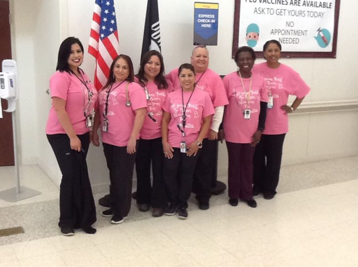 VA employees show their support for this year's Breast Cancer Awareness Month by posing for a group photo while wearing the same style of pink t-shirts on October 17, 2018, at the VA specialty clinic in Corpus Christi,Texas. (U.S. Department of Veterans Affairs photo by Victor Barrera)