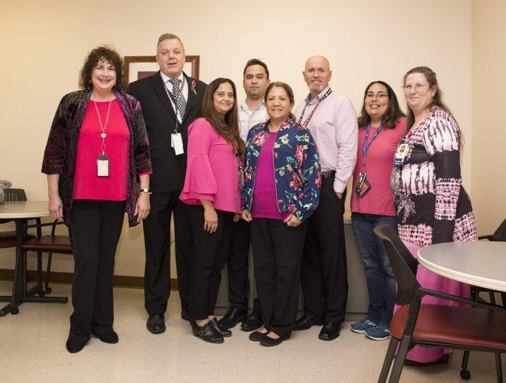 VA employees pose for a group photo wearing different pink garments on October 17, 2018, at the VA admin building in Harlingen,Texas, in observance of this year's Breast Cancer Awareness Month. (U.S. Department of Veterans Affairs photo by Luis H. Loza Gutierrez)