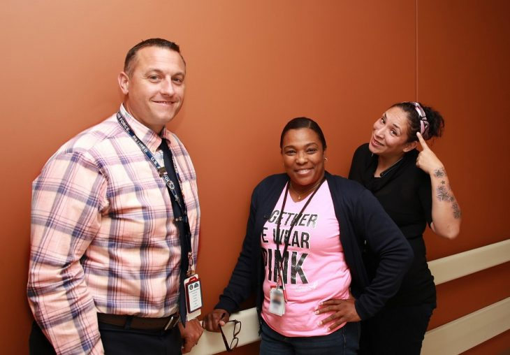 VA employees pose for a group photo wearing different pink garments on October 17, 2018, at the VA Health Care Center at Harlingen,Texas, in observance of this year's Breast Cancer Awareness Month. (U.S. Department of Veterans Affairs photo by Luis H. Loza Gutierrez)