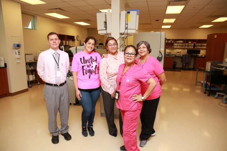VA employees pose for a group photo while wearing pink clothing items on October 17, 2018, at the VA Health Care Center at Harlingen,Texas, in observance of this year's Breast Cancer Awareness Month. (U.S. Department of Veterans Affairs photo by Luis H. Loza Gutierrez)
