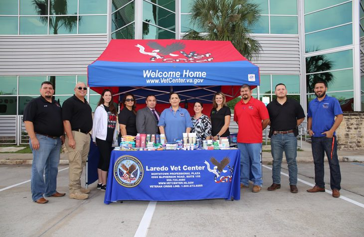 VA employees and event volunteers pose for a group photo during the Boots & Badges care package drive held October 26, 2018, at Vet Center in Laredo, Texas. The drive thru and drop off event collected approximately 1,100 individual donated items for the day. All donated items are being collected for care packages, which will then be sent to deployed service members from Laredo, Texas. (U.S. Department of Veterans Affairs photo by Luis H. Loza Gutierrez)