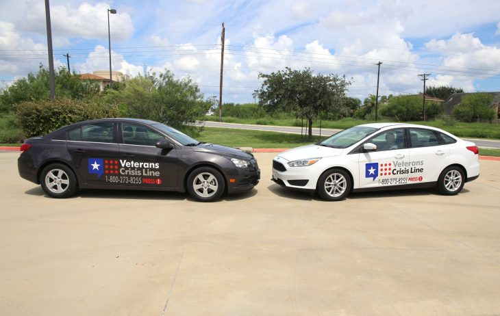 Image of two government owned vehicles (GOV) with Veterans Crisis Line decal graphics was part of VA Texas Valley Coastal Bend Health Care System's (VCB) efforts to raise awareness during this year's observance of Suicide Prevention Month. Image taken September 17, 2018, at the VA Health Care Center at Harlingen, Texas. (U.S. Department of Veterans Affairs photo by Luis H. Loza Gutierrez)