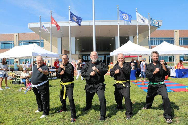 Chagnon and four Veterans getting in shape with karate exercises